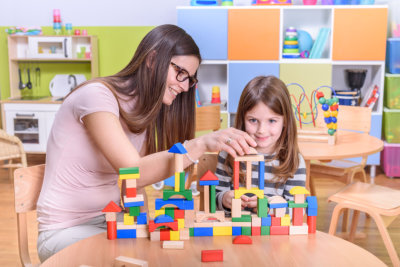occupational therapists helping and supporting the child during treatment sessions