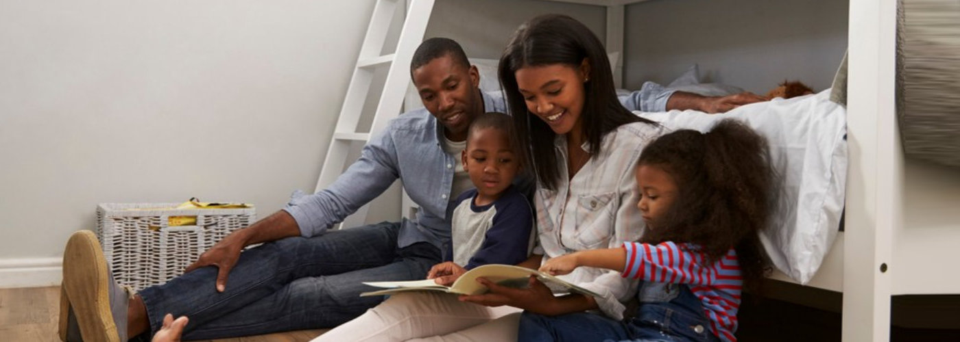 parents reading story to children